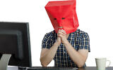 Illustrative photo: A man with a bag over his head on a computer. (verbaska_studio/iStock by Getty Images)