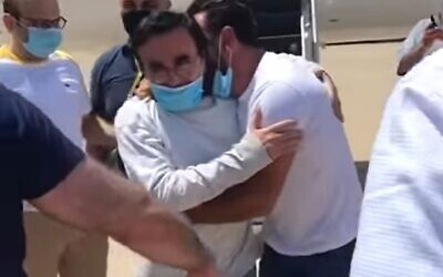 Kassim Tajideen (C) arrives back in Beirut after he was sentenced last year in a US federal court for laundering money for Hezbollah, July 8, 2020 (Screen grab/LBC)