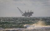A view of the Leviathan natural gas processing rig from Dor Habonim Beach Nature Reserve, January 1, 2020. (Flash90)