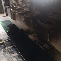 Charred sinks in an el-Bireh mosque that was torched overnight July 27, 2020, in an apparent hate attack by extremist Jews (Iyad Hadad/B'Tselem)