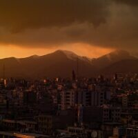 Illustrative: A view of Tehran at dusk. (Omid Armin on Unsplash)