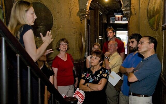 A group takes a tour of the Tenement Museum, which tells the stories of Jewish and other immigrants to New York, in 2008. (Kiko Niwa via JTA)
