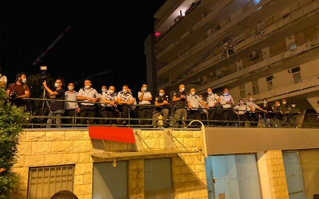 Police observing dispersal of anti-Netanyahu protesters early morning on Sunday, July 26, 2020 (Anat Peled/Times of Israel)