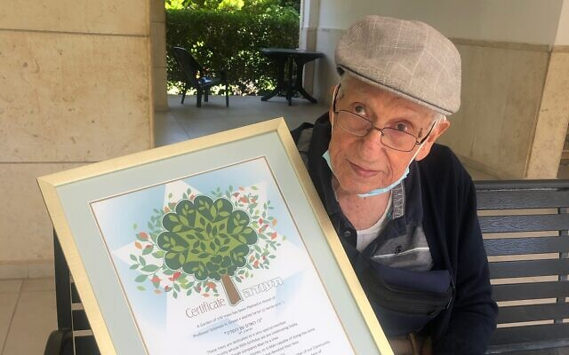 Prof. Sol Green with the certificate from the Keren Kayamet LeIsrael-Jewish National Fund honoring him on his 99th birthday with the planting of 100 trees in his name, July 15, 2020, Jerusalem. (Courtesy)