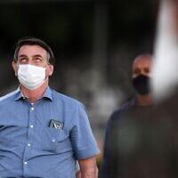 Brazilian President Jair Bolsonaro attends the flag unveiling ceremony in the garden of the Alvorada Palace in Brasilia, on July 24, 2020. (EVARISTO SA / AFP)