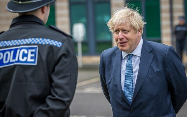 Britain's Prime Minister Boris Johnson speaks to police officers during a visit to North Yorkshire Police headquarters in Northallerton, northeast England on July 30, 2020. (Charlotte Graham / POOL / AFP)