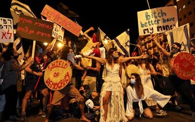 Protesters, mask-clad due to the coronavirus pandemic, gather for a demonstration against the government near the Prime Minister's Residence in Jerusalem on August 1, 2020. (Menahem Kahana/AFP)