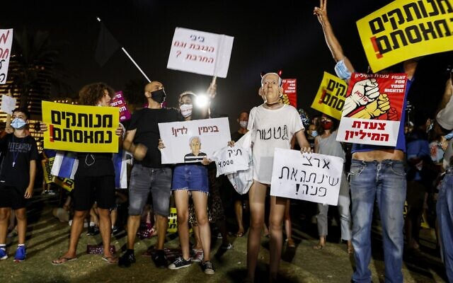 Israelis protest against the government's economic policies during the coronavirus pandemic in Tel Aviv on August 1, 2020. (Jack Guez/AFP)