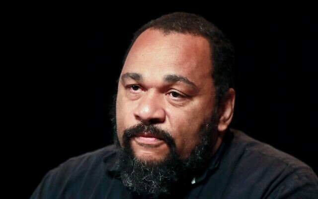In this file photo taken on May 20, 2017 French controversial humorist Dieudonne M'bala M'bala looks on during a press conference at the Theatre de la Main d'Or in Paris (JACQUES DEMARTHON / AFP)