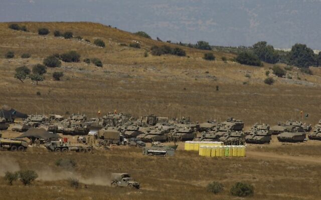 Military vehicles are amassed in the Golan Heights on August 3, 2020. (JALAA MAREY / AFP)