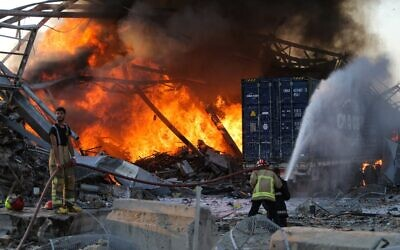 Firefighter douse a blaze at the scene of an explosion at the port of Lebanon's capital Beirut, on August 4, 2020. (STR / AFP)