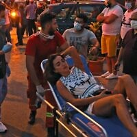 A woman is wheeled into a hospital following an explosion in the Lebanese capital Beirut on August 4, 2020. (Ibrahim Amro/AFP)