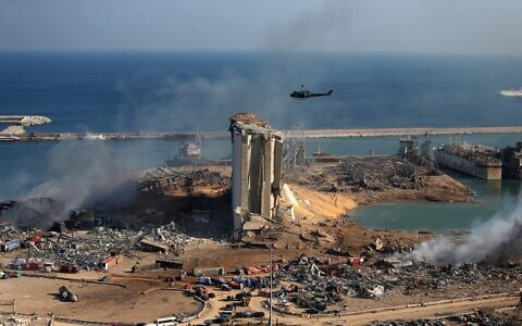 The damaged grain silos at Beirut's harbor are seen on August 5, 2020, a day after a massive explosion at the port. (Stringer/AFP)