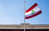 The Lebanese flag flies at half-staff at the Lebanese embassy in The Hague, The Netherlands, on August 5, 2020, after a powerful explosion tore through Lebanon's capital. (Robin Utrecht/ANP/AFP)