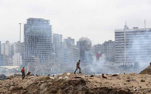 A soldier walks at the site of the massive explosion at the port of Beirut on August 6, 2020. (Thibault Camus/Pool/AFP)