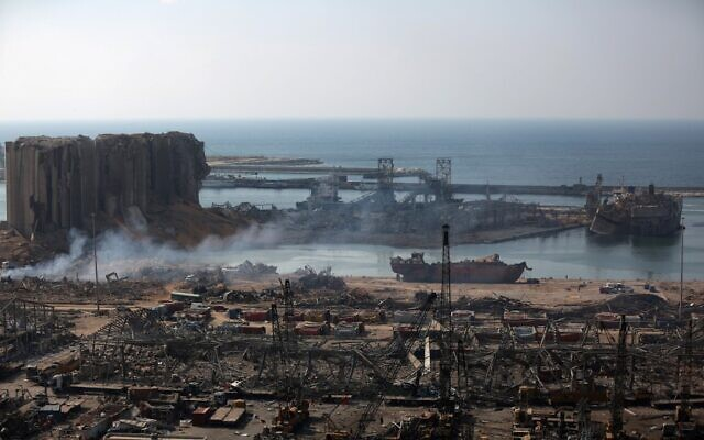 A partial view of the devastated Beirut port is pictured from the nearby neighbourhood of Mar Mikaehl on August 6, 2020, two days after a massive blast there shook the Lebanese capital. (Patrick BAZ / AFP)