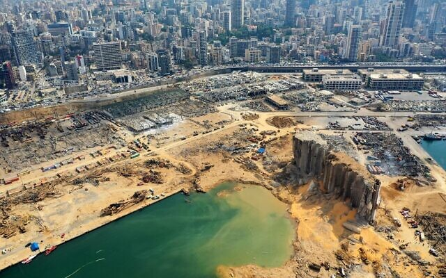 An aerial view taken on August 7, 2020, shows a partial view of the port of Beirut and the crater caused by the colossal explosion three days earlier of a huge pile of ammonium nitrate that had languished for years in a port warehouse, left scores of people dead or injured and caused devastation in the Lebanese capital. (AFP)