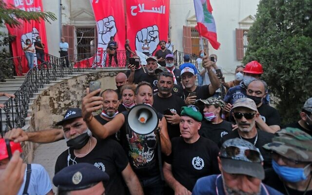 Lebanese protesters are pictured inside the foreign ministry in Beirut on August 8, 2020. (Stringer/AFP)