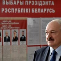 Belarus' President Alexander Lukashenko arrives to vote at a polling station during the presidential election in Minsk on August 9, 2020. (Sergei GAPON / POOL / AFP)
