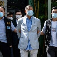 Police lead Hong kong pro-democracy media mogul Jimmy Lai (C) away from his home after he was arrested under the new national security law in Hong Kong on August 10, 2020. (Vernon Yuen/AFP)