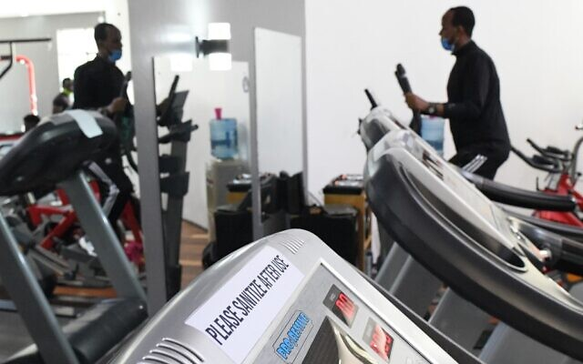A man uses a treadmill machine at a fitness gym in Nairobi, with due observance of safety regulations, after some coronavirus lockdown restrictions are eased, on August 10, 2020. (Simon MAINA/AFP)