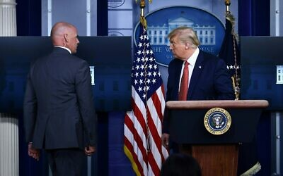 US President Donald Trump being removed by a member of the secret service from the Brady Briefing Room of the White House in Washington, DC, on August 10, 2020. (Brendan Smialowski / AFP)