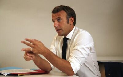 French President Emmanuel Macron speaks during a Defense Council video-conference on Niger at the Fort de Bregancon, southern France on August 11, 2020. (Daniel Cole / POOL / AFP)