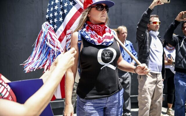 Conspiracy theorist QAnon demonstrators protest during a rally to re-open California and against Stay-At-Home directives on May 1, 2020 in San Diego, California. (Sandy Huffaker/AFP)
