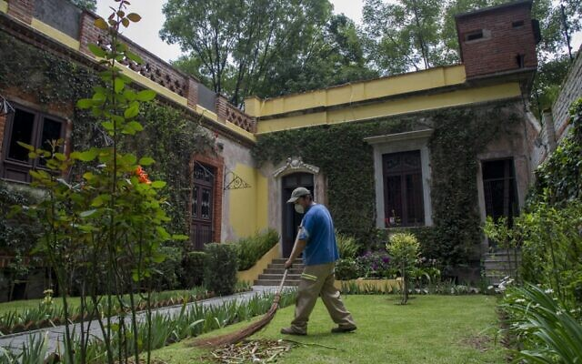 A man works in the garden of the House Museum of Russian revolutionary, political theorist and politician Leon Trotsky, one of the leaders of the Russian Revolution, in the Coyoacan neighborhood of Mexico City, on August 10, 2020.(Photo by CLAUDIO CRUZ / AFP)