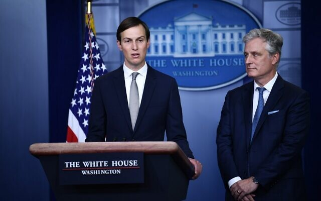 Senior Advisor Jared Kushner, left, speaks as National Security Advisor Robert O'Brien looks on during a press briefing in the James S. Brady Press Briefing Room at the White House, in Washington, DC on August 13, 2020. (Brendan Smialowski / AFP)