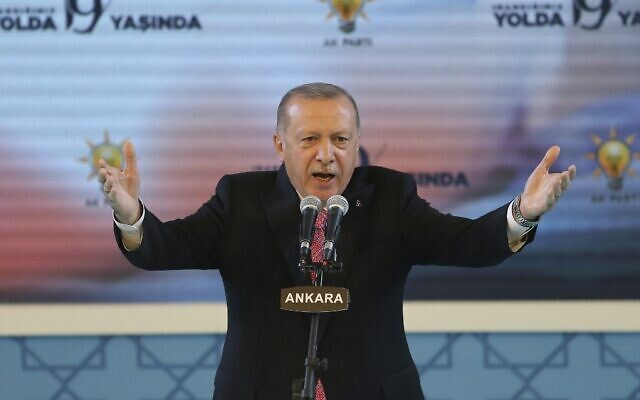 Turkish President Recep Tayyip Erdogan gestures as he delivers a speech in Ankara, on August 13, 2020. (Photo by Adem ALTAN / AFP)