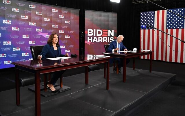 Democratic presidential nominee, former US Vice President Joe Biden (R), and vice presidential running mate, US Senator Kamala Harris, sign required documents for receiving the Democratic nomination for President and Vice President, in Wilmington, Delaware, August 14, 2020. (MANDEL NGAN/AFP)