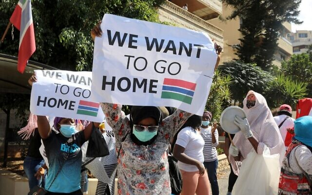 Gambian migrant workers protest in front of the consulate of Gambia on August 20, 2020, in Beirut, asking to be evacuated from Lebanon and be repatriated to their country. (ANWAR AMRO / AFP)