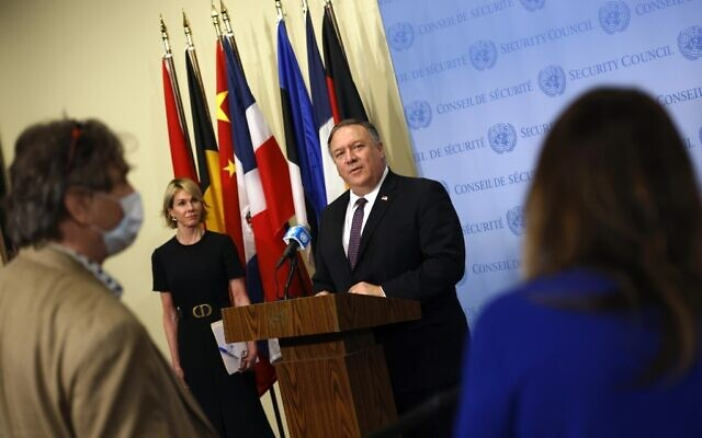 US Secretary of State Mike Pompeo is flanked by US Ambassador to the United Nations Kelly Craft as he speaks to reporters following a meeting with members of the UN Security Council about Iran's alleged non-compliance with a nuclear deal and calling for the restoration of sanctions against Iran at United Nations headquarters in New York, August 20, 2020. (MIKE SEGAR / POOL / AFP)