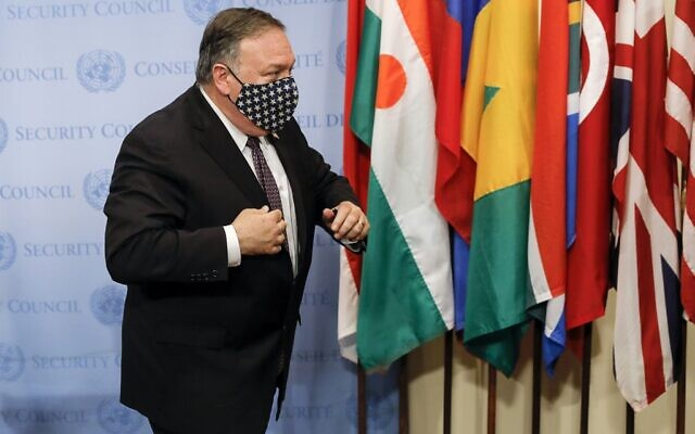 US Secretary of State Mike Pompeo wears a facemask as he departs after speaking to reporters following a meeting with members of the UN Security Council about Iran's alleged non-compliance with a nuclear deal and calling for the restoration of sanctions against Iran at United Nations headquarters in New York, August 20, 2020. (MIKE SEGAR / POOL / AFP)