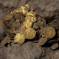 A hoard of gold coins dating to the Abbasid Caliphate is pictured during a press presentation of the discovery at an archeological site near Tel Aviv in central Israel (Heidi Levine / POOL / AFP)