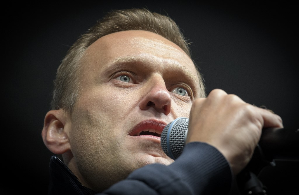 Russian opposition leader Alexei Navalny delivers a speech during a demonstration in Moscow