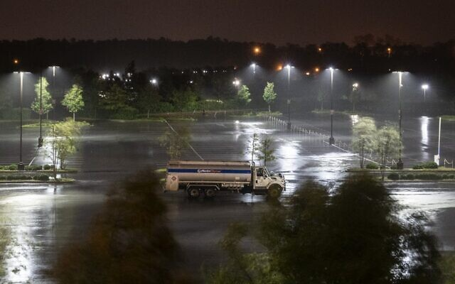 A single truck is parked in an open lot as heavy rains from hurricane Laura fall in Lake Charles, Louisiana, on August 26, 2020. (Andrew Caballero-Reynolds/AFP)
