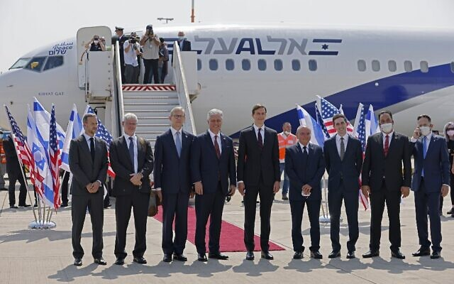 US Presidential Adviser Jared Kushner (C-R) and US National Security Adviser Robert O'Brien (C-L) pose with members of the Israeli-American delegation in front of the El Al's flight LY971, which will carry the delegation from Tel Aviv to Abu Dhabi, at the Ben Gurion Airport near Tel Aviv on August 31, 2020. (Menahem Kahana / AFP)