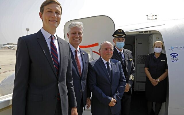 US Presidential Adviser Jared Kushner (L), US National Security Adviser Robert O'Brien (2nd-L) and Head of Israel's National Security Council Meir Ben-Shabbat (C) pose for a picture with the flight crew ahead of boarding the El Al's flight LY971, which will carry an Israeli-American delegation from Tel Aviv to Abu Dhabi, at the Ben Gurion Airport near Tel Aviv on August 31, 2020.(Photo by NIR ELIAS / POOL / AFP)