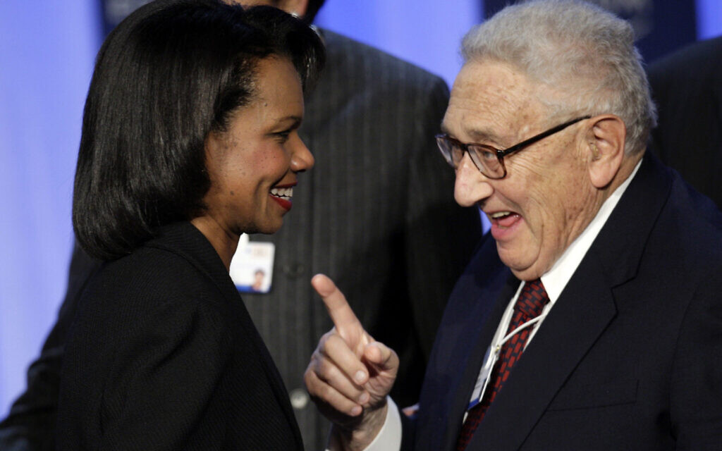 US Secretary of State Condoleezza Rice, left, speaks former secretary of state Henry Kissinger after the opening plenary session on the first day of the Annual Meeting of the World Economic Forum, WEF, in Davos, Switzerland, January 23, 2008. (AP Photo/Keystone, Laurent Gillieron)