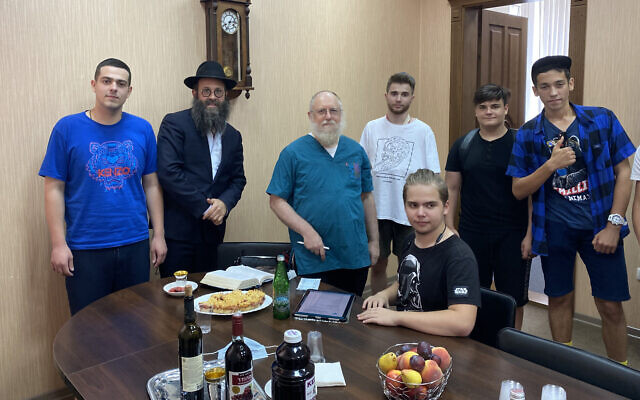 Rabbi Chaim Danzinger, left, introduces Dr. Yeshaya Shafit, second from left, to Jews awaiting circumcision at the synagogue of Rostov-on-Don in Russia, July 27, 2020. (Courtesy of the Jewish Community of Rostov/ via JTA)