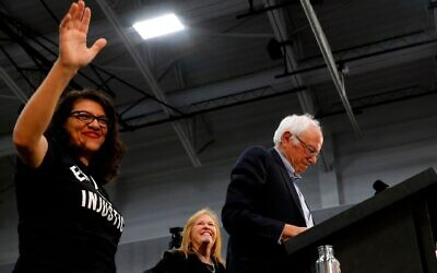 Rep. Rashida Tlaib waves as she endorses then-Democratic presidential hopeful Sen. Bernie Sanders at a campaign rally in Detroit, October 27, 2019. (Jeff Kowalsky/AFP via Getty Images/ via JTA)