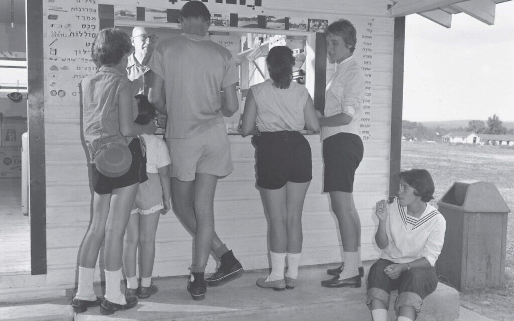 Hebrew was the public language of Camp Ramah in the 1950s, with many words borrowed from the Massad lexicon, including the term 'Chanutiya' (canteen) above the take-out window in this image. Note that the menu item are described with drawings rather than translated into English. (National Ramah Commission)