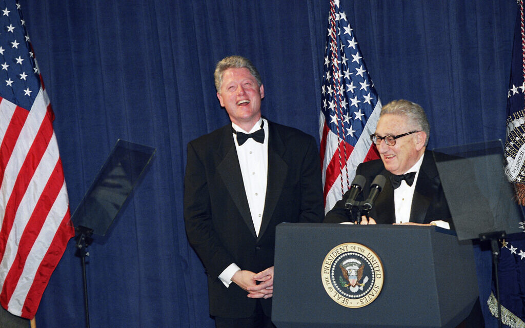 Former Secretary of State Henry Kissinger with Bill Clinton, sharing a laugh after then-president Clinton gave the closing remarks at a national policy conference, March 1, 1995. (AP Photo/J. Scott Applewhite)
