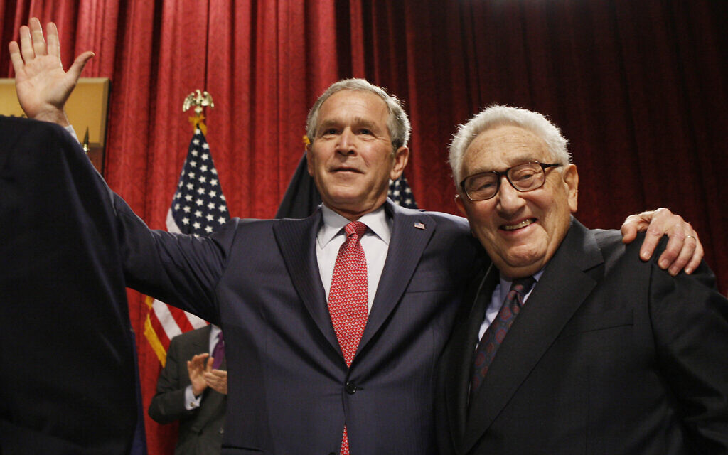 Former Secretary of State Henry Kissinger with then-president George W. Bush in New York City, March 14, 2008.  (AP Photo/Charles Dharapak)