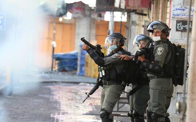 Soldiers fire tear gas in Hebron on August 28, 2020. (WAFA)
