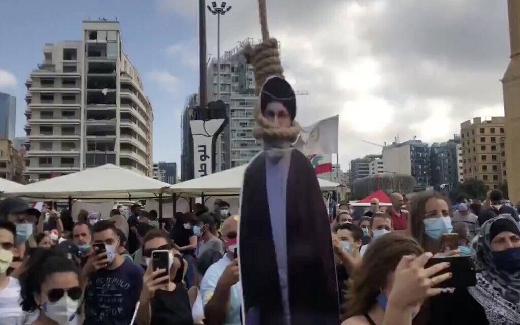 A cardboard cutout of Hezbollah leader Hassan Nasrallah is hung in a noose during a demonstration in Beirut on August 8, 2020, following the deadly blast in the Lebanese capital. (Screen capture: Twitter)