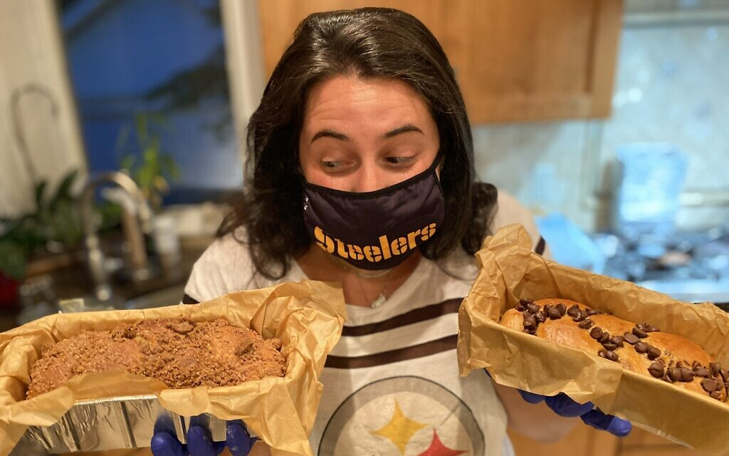 Sara Loffman of the Challah Back Girls weighing the options -- coffee crumb or chocolate chip. (Courtesy)