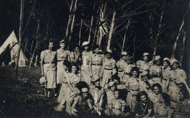 A group of detained girls in a youth movement activity in a grove in Mauritius. (Courtesy Ghetto Fighters' House Archives, Israel)